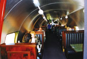 The Plane S Interior Which Now Serves As A Dining Area Has Been Reed With Booths New Aluminum Facing And Track Lighting